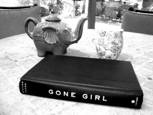 I read this on the back porch with the cutest tea pot ever :)